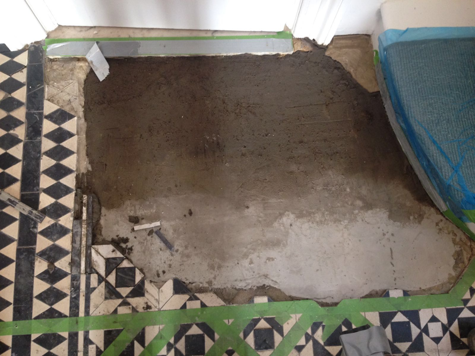 Victorian tiled floor before repair Islington