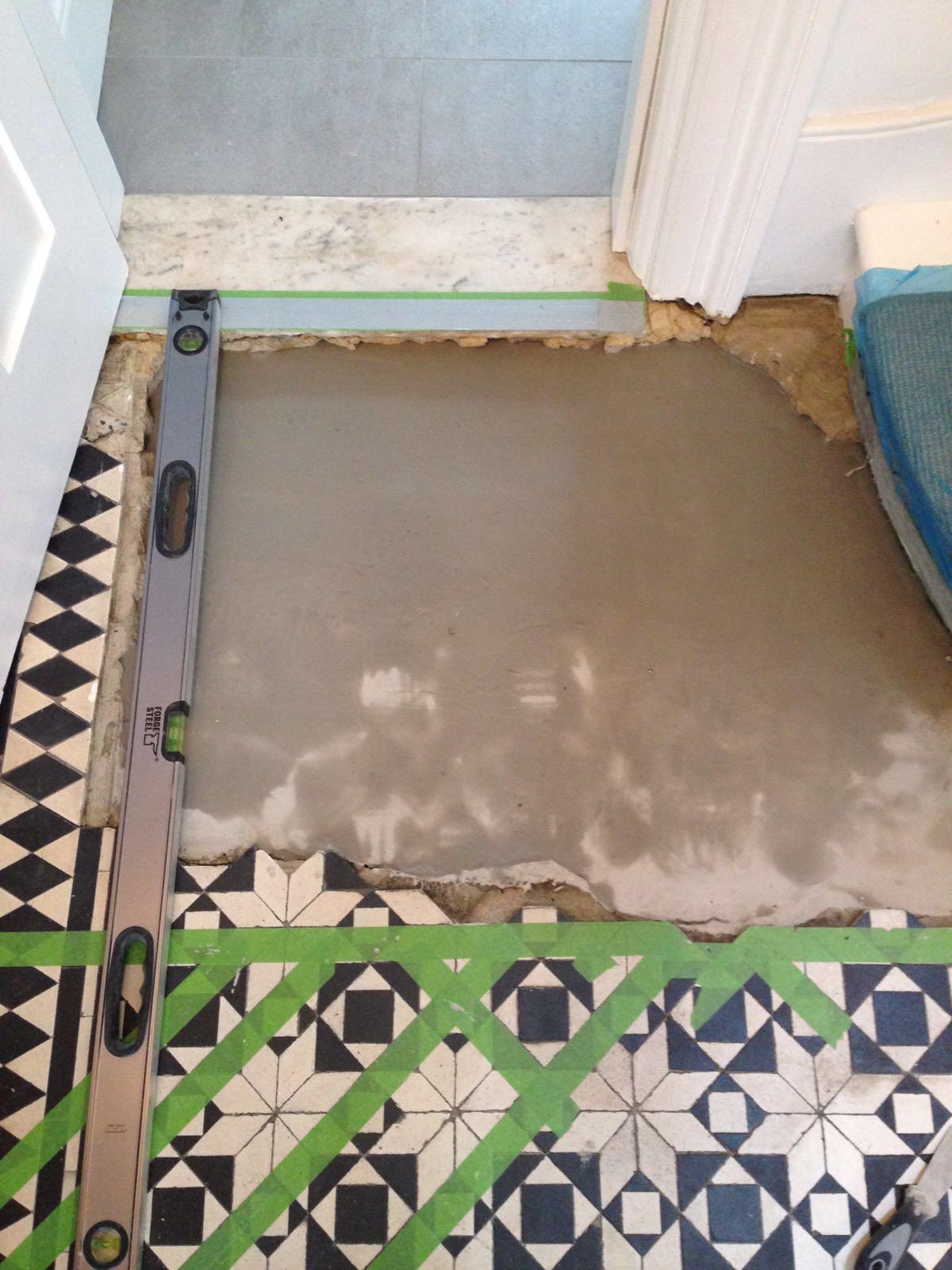 Victorian tiled floor before repair Islington