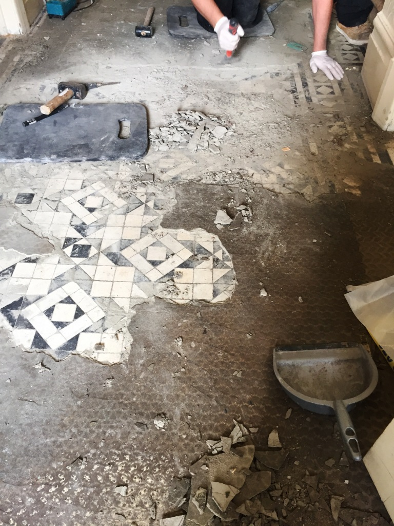 Removing Concrete Leveller From Victorian Floor Tiles in Woodford Green